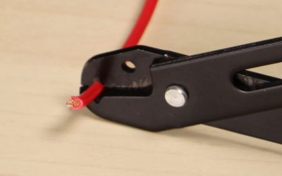 use the wire strippers to strip off 38u2033 of the speaker wire insulation
