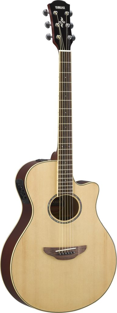 Acoustic guitar with natural toned wood finish.