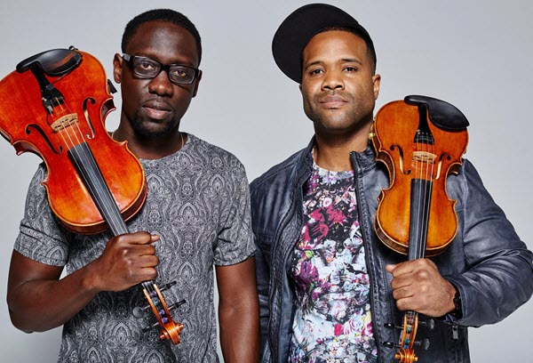 Two young African-American men with violins.