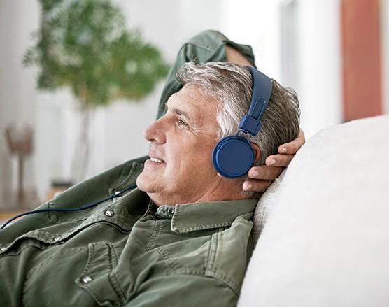A man wearing headphones, relaxing.
