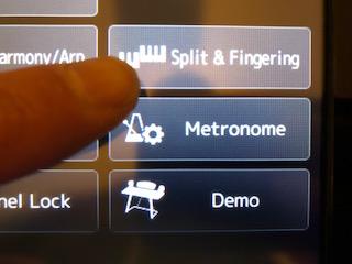 "Finger pressing ""Split and Fingering"" on a screen."