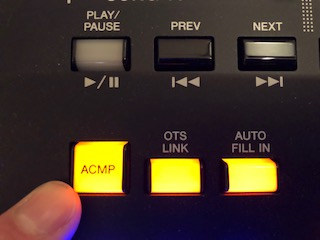 "Finger pressing button marked ""ACMP""."