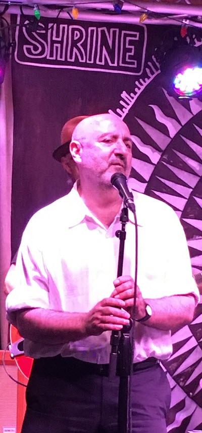 Man singing on stage.
