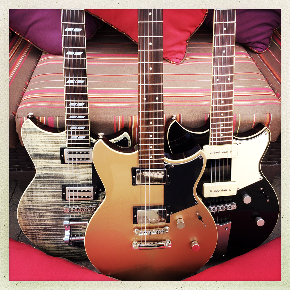 Three electric guitars lined up.