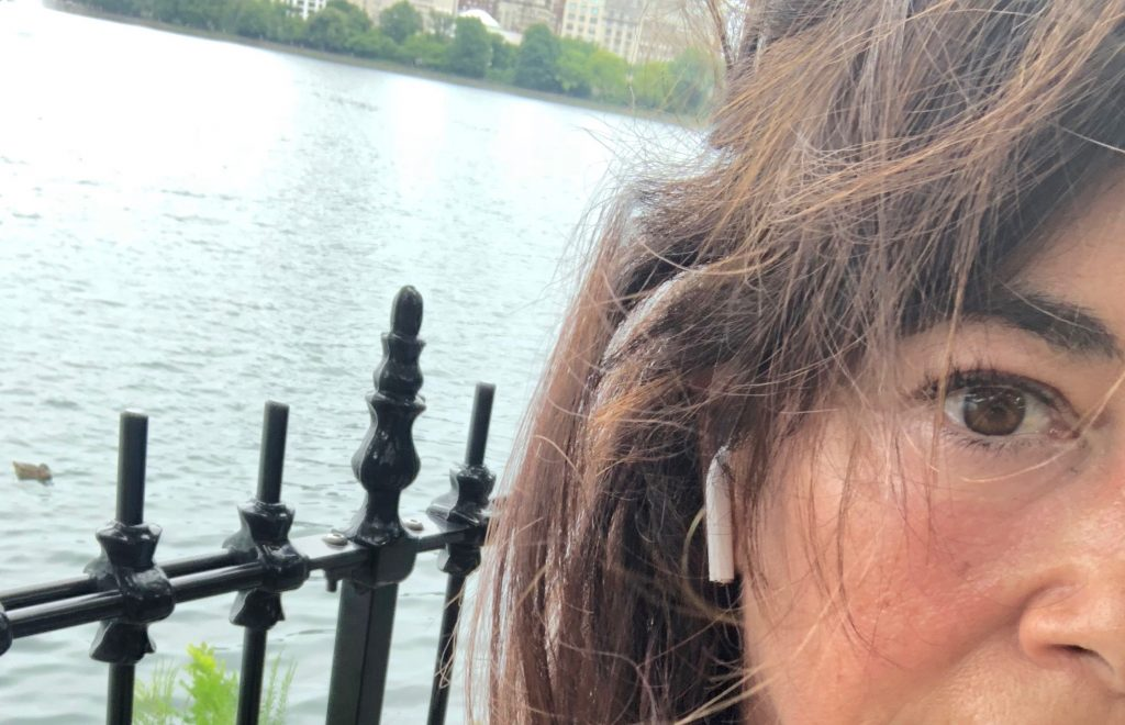 Shelly Peiken selfie photo with a lake as background.
