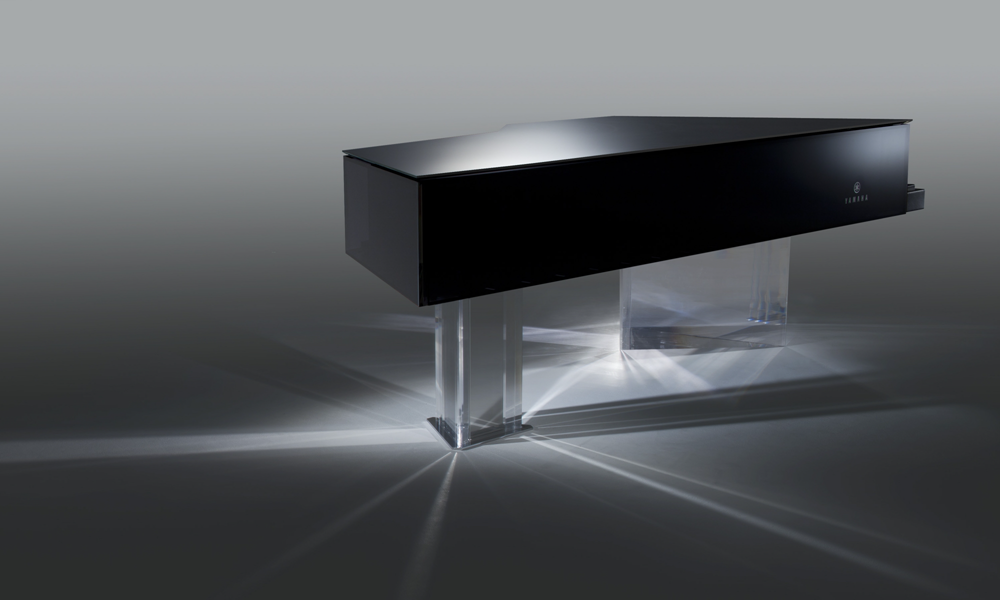 A black bodied custom piano with acrylic base.