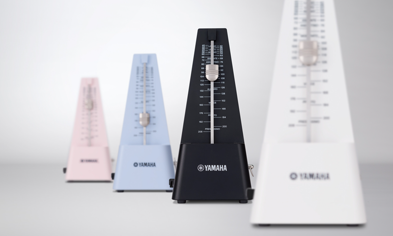 Four metronomes in different colors.