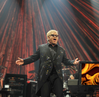 Elton John singing on stage.