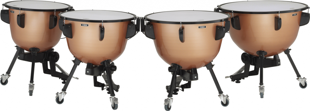 Set of four matched timpani drums.