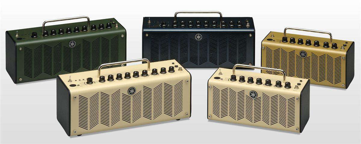 Five small guitar amps lined up in two lines.
