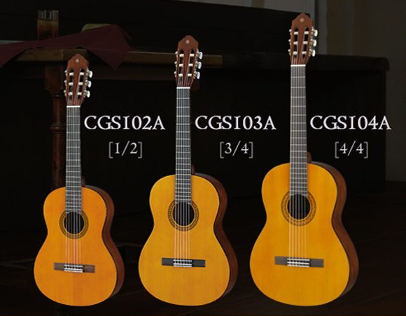 A lineup of three acoustic guitars lined up smalled to largest (1/2 to 3/4 to 4/4 size).