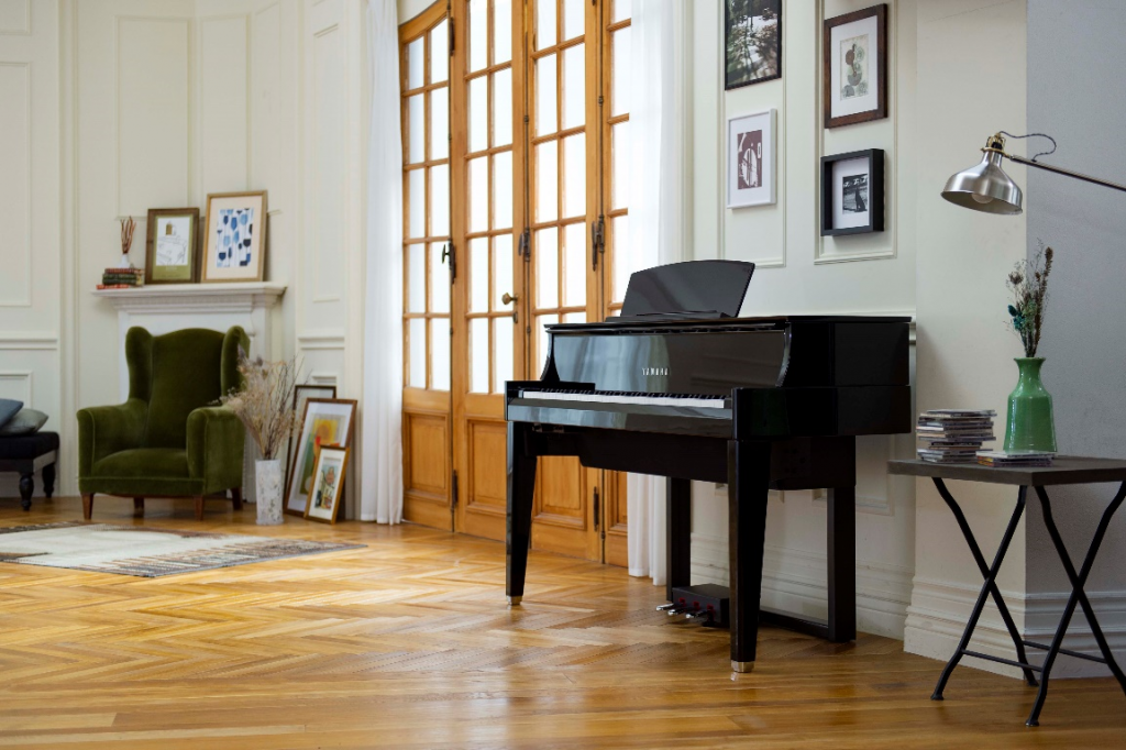 Electronic keyboard that looks almost like an upright piano in an apartment setting.