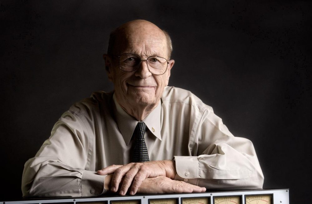 A photograph of Rupert Neve. He is an elderly man with glasses. He appears friendly and has an endearing smile.