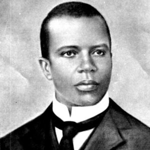 Drawing of a young African American man with a tight cropped haircut in a suit with a standup collar and tie.