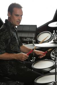 Man playing electronic drum kit.