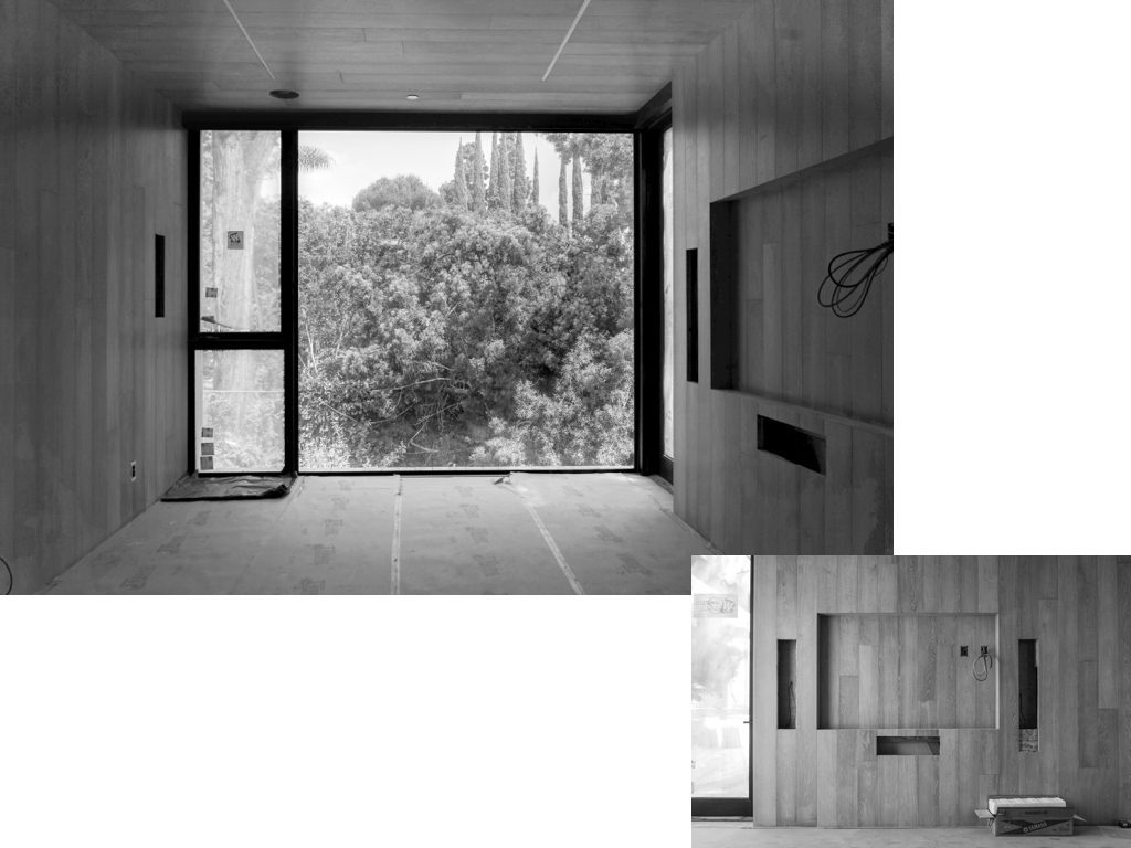 Pair of images showing a room with floor to ceiling windows at one end overlooking trees and the other wall which is wood floor to ceiling with a cutout/indentation for a flat screen television.