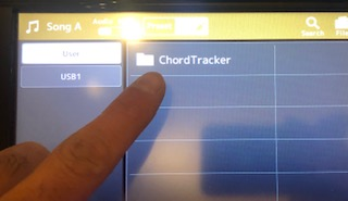An image of a Genos digital display with the Chord Tracker folder highlighted.