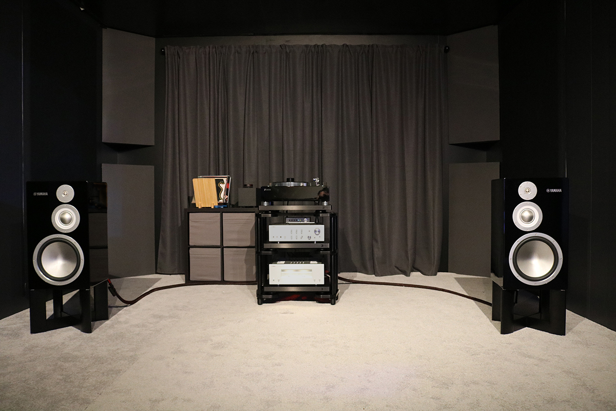 An image of a surround sound system with two speakers and a subwoofer.