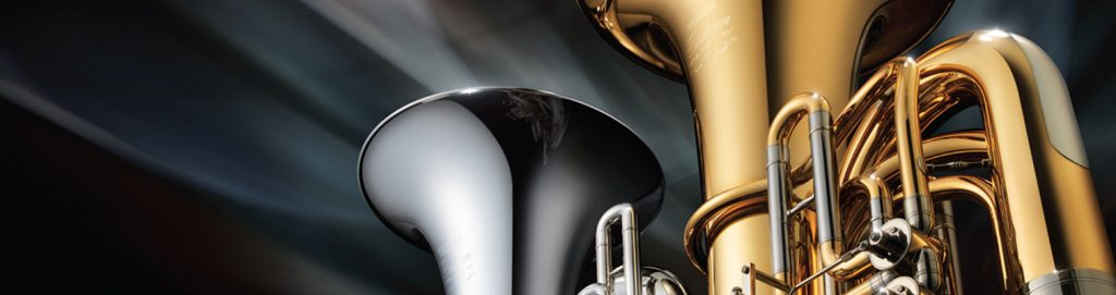 View of the bells of a brasstoned and a silvertoned tuba.