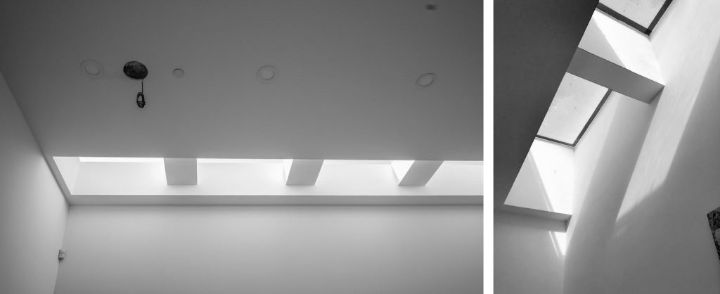 Two photos of skylights in a modern house. One set of four are on a flat ceiling with the other set of two lights are at a 45 degree angle.