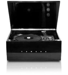 An image of an old-fashioned vinyl record player. It is self-encased within a box.