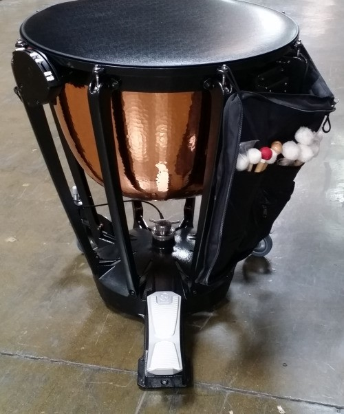 An image of a timpani with a mallet bag attached.
