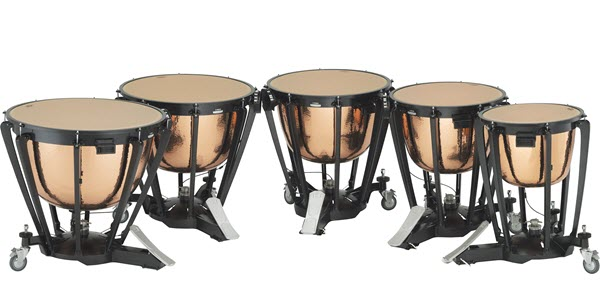 Five timpani drums in a curved row with pedals facing into center.
