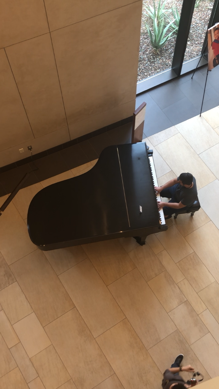 An overhead image of someone playing the piano.