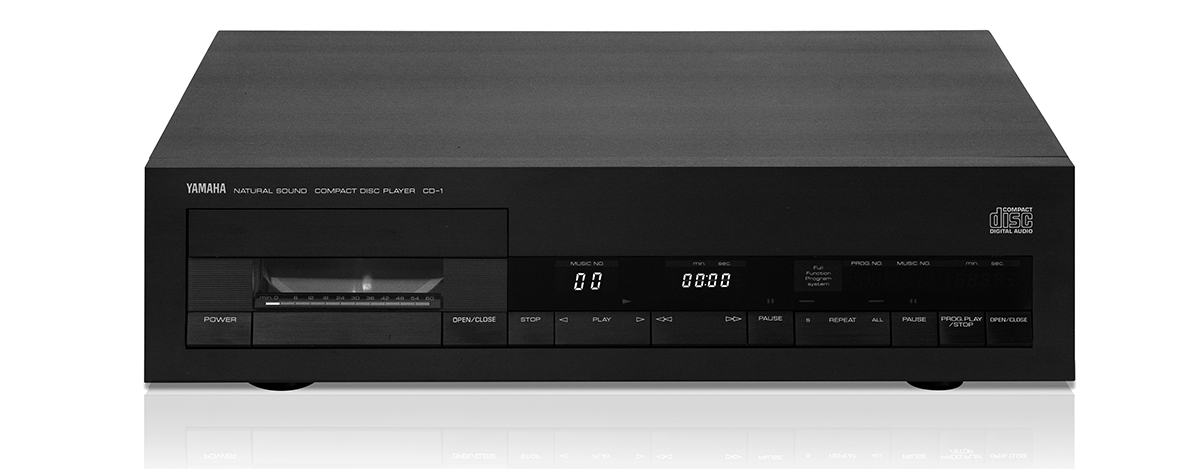 An image of an old-fashioned CD player. It is a large box that looks similar to a VHS player.