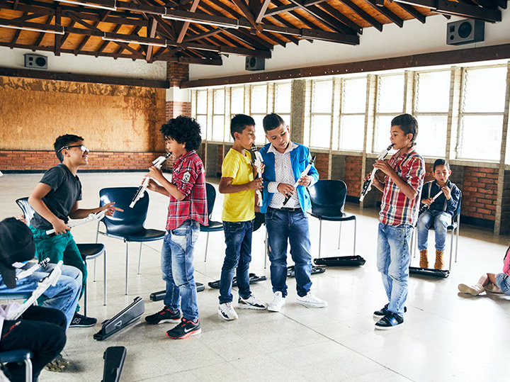 A group of children playing musical instruments.