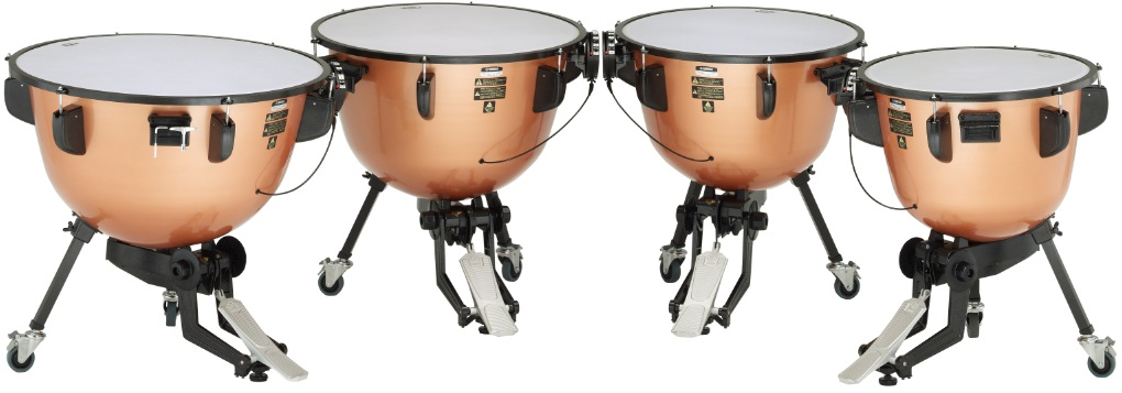 Set of four timpani drums in a curved row.