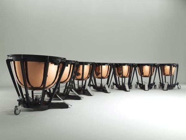 Curved row of timpani with 7 timpani drums.