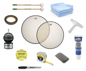 "A collection of materials listed above: timpani heads, mallet, cloths, squeegee, softball, steel wool pad, Sharpee marker, tube of lithium grease, and a gauge called a ""DrumDial""."
