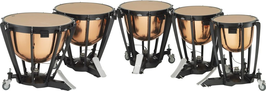 Curved row of 5 timpani drums.