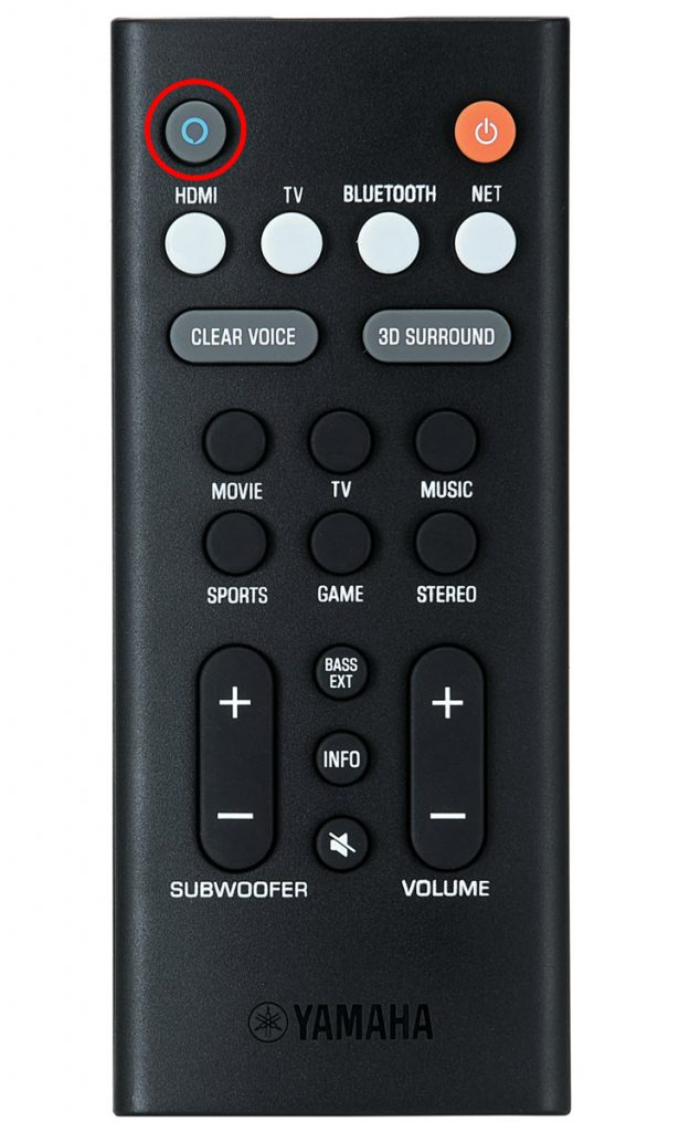 Closeup of a remote control with Alexa button indicated.