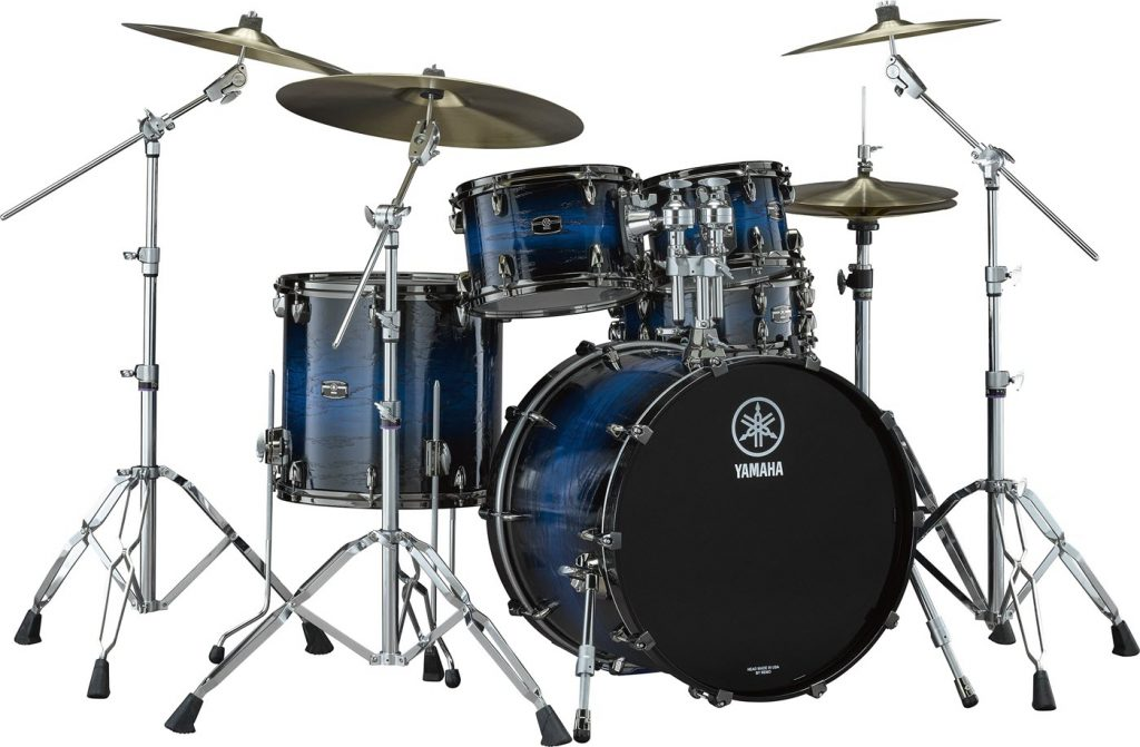 Full drum kit with four cymbals, a tenor, two snares and a bass drum.