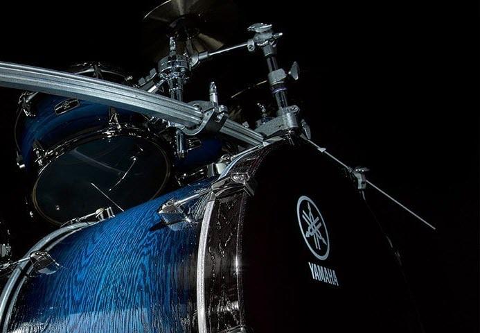 Closeup of drum set with Yamaha logo visible.
