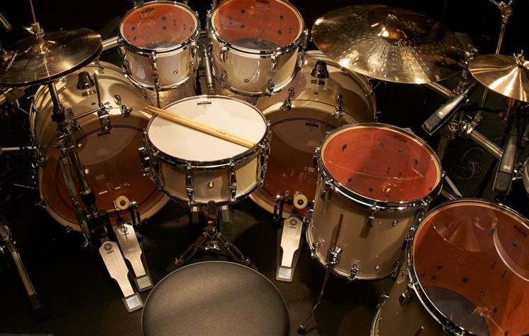 Drum set with multiple drums, cymbals, pedals and sticks.