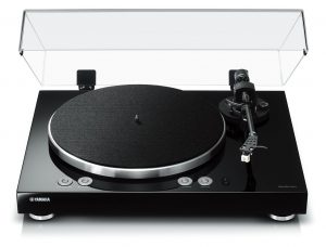 Modern turntable with clear lid lifted.