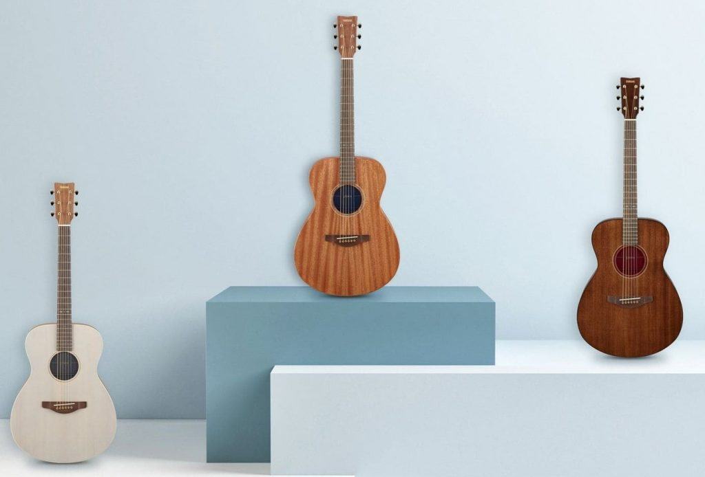 Three acoustic guitars.