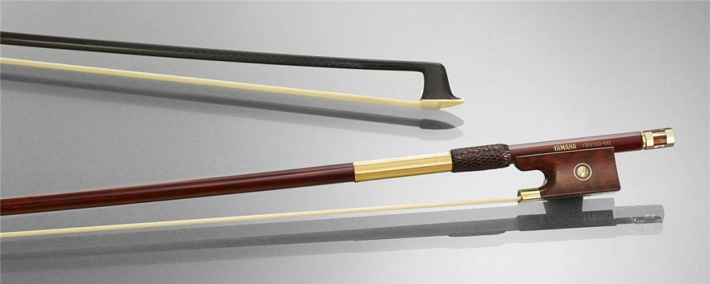 Closeup of two carbon bows for stringed instruments.
