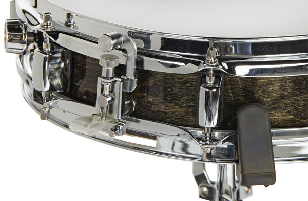 Closeup of edge and connection for snare drum to stand.