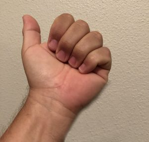 Hand palm up with fingers curled as if forming the beginning of a fist.