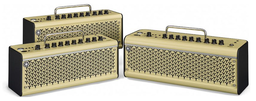 Three small box shaped guitar amplifiers with handles.