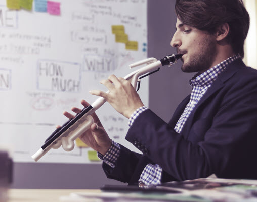 Teacher playing a wind instrument in a classroom.