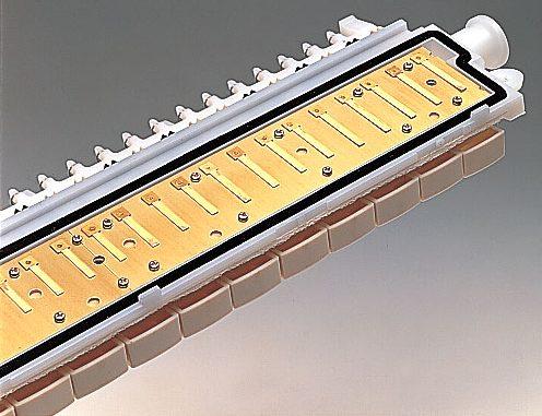 Close-up of the Yamaha Pianica's thin metal reeds.
