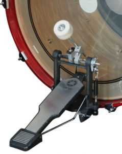 Bass drum foot pedal with red bass drum on white background.