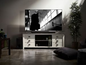 Living room entertainment center with television and sound bar.
