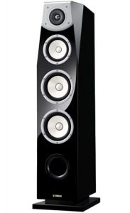 Tall freestanding floor speaker.