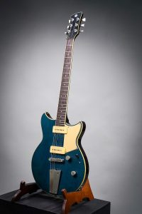 Yamaha Revstar 502TFM electric guitar with a subtle flame maple top in a Vintage Japanese Denim finish.